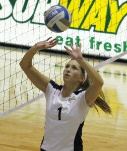 Photo by: Chad Kenney/Freshman setter Katalin Minnerly (1) sets the ball in prep for a GSU point.