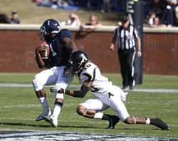 Photo+by%3A+Lindsay+HartmannJunior+quarterback+Jerick+McKinnon+%281%29+spins+around+a+tackle+during+the+31+-+28+loss+to+Appalachian+State+on+Saturday.