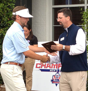 Courtesy+of%3A+GSU+athleticsThe+Georgia+Southern+University+golf+team+claimed+fifth+place+at+the+SoCon+tournament.+Left%3A+Sophomore+Scott+Wolfes+accepts+the+SoCon+Golfer+of+the+Year+plaque.+Wolfes+averaged+71.50+strokes+per+round.+Right%3A+Sophomore+Charlie+Martin+watches+his+shot.+Martin+averages+74.27+strokes+per+round.