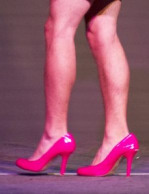 Men walk a mile in her shoes, literally