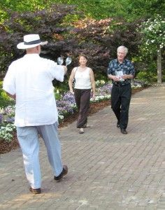 Courtesy of: Julie ChurneyA Garden of the Coastal Plains volunteer welcomes patrons to the annual Wine, Moonlight and Magnolias at last year's event. The garden will host its 13th annual event tonight from 7-9 p.m.
