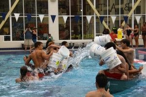 Battleship takes place each year at the RAC in October. Opposing teams try to sink each others canoe, with four teams in the pool at a time. The last team floating wins.Photo by: Drew Heimlich