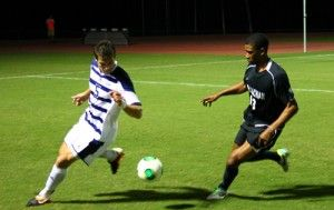 Senior defender Thomas Valikonis (3) dribbles the ball as Appalachian State University sophomore midfielder Alex Herbst (18) goes for the steal.Photo by: Ryan Woodham