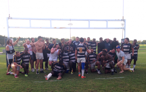 The Georgia Southern Rugby team celebrates the winning of thetournament. The victory included wins over the Ga. Southern alumni team (The Southern Exiles) and Valdosta State in the title game.