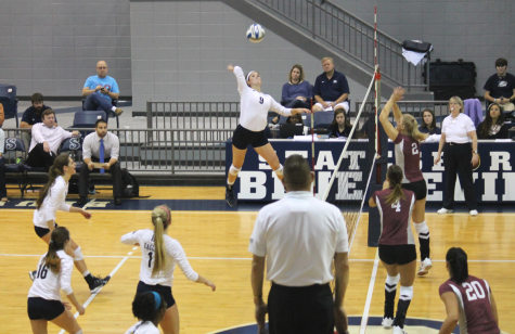 Senior outside hitter Jamie DeRatt (9) recorded 30 kills over a weekend that saw the Eagles go 1-1 in conference play.