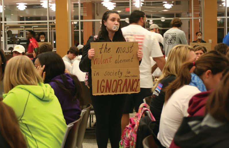 A student protests as others eat their midnight breakfast Dec. 8.
