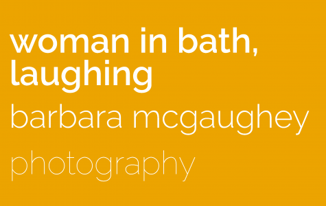 woman in bath, laughing