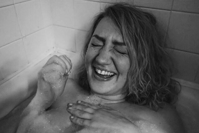 woman in bath, laughing Barbara McGaughey