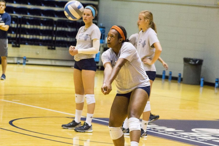 The Volleyball team ready for the FAU Invitational