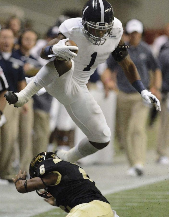 Georgia Southern's L.A Ramsby leaps over University of Idaho's Kendrick Trotterfor a big gain in the second quarter, September 26, 2015 in Moscow Idaho.