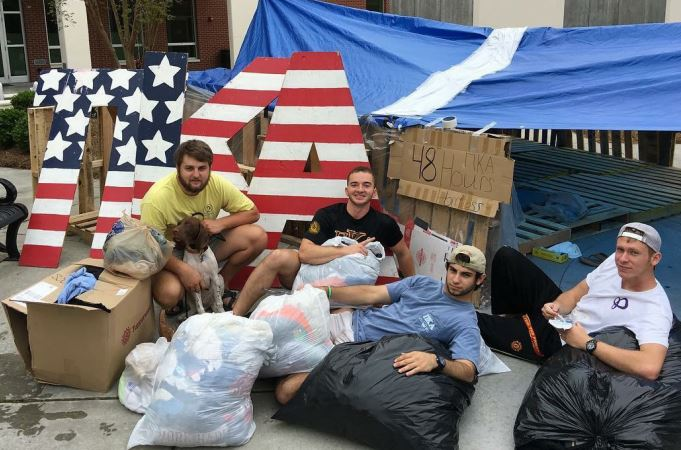 Brothers of the Pi Kappa Alpha fraternity pose with some donations at their homeless camp outside the student union. (Photo courtesy of Julius Rodillas )