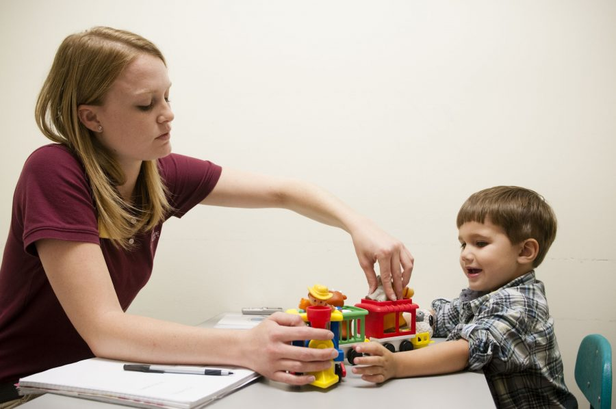 An Armstrong student plays with a boy and a toy train (Photo by Katherine Arntzen)