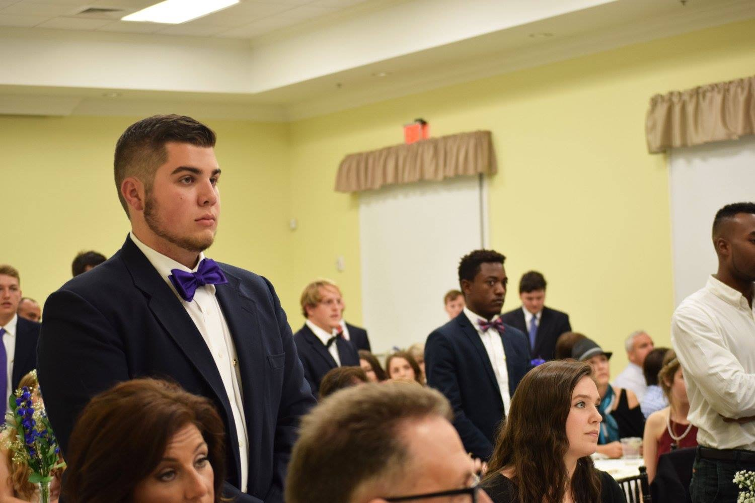 Brothers stand to be recognized during the banquet