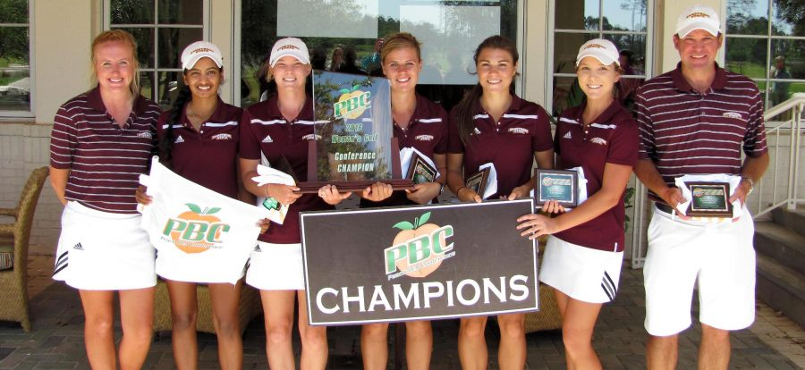 The Armstrong women's golf team and coaches Michael Butler and Jenna Birch celebrate their PBC Tournament championship. The team held off the Flagler Lions to complete a wire-to-wire showing in the tournament. Sunday, April 17, 2016 (Armstrong Communications)