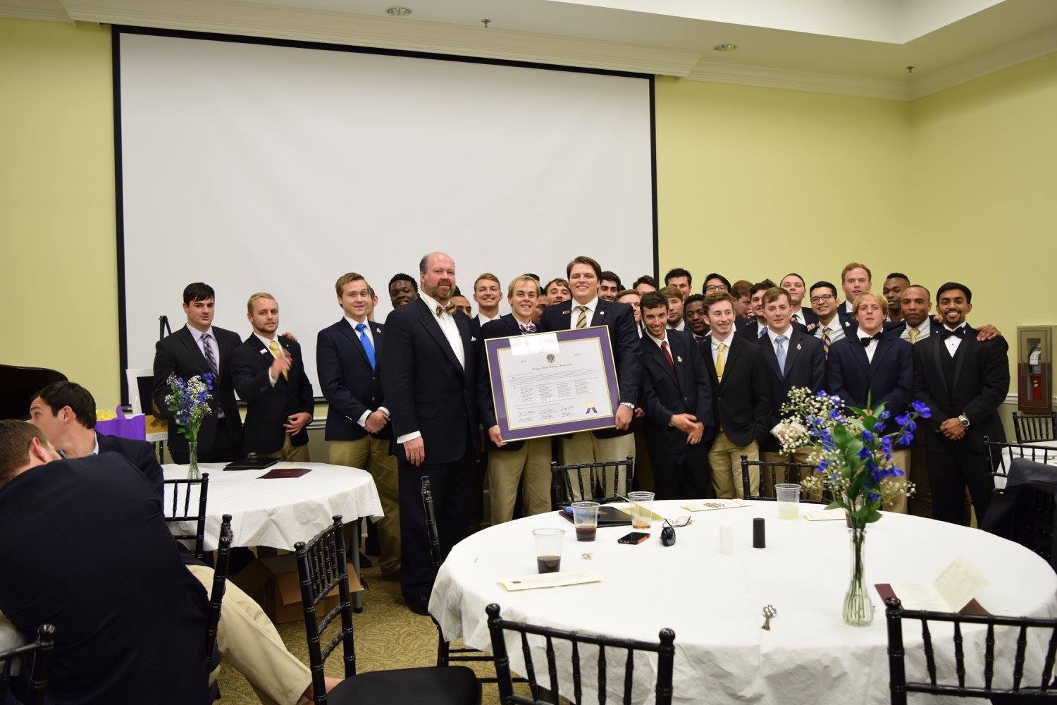 Initiated members of the Phi Alpha chapter and the National president of Sigma Alpha Epsilon with their charter