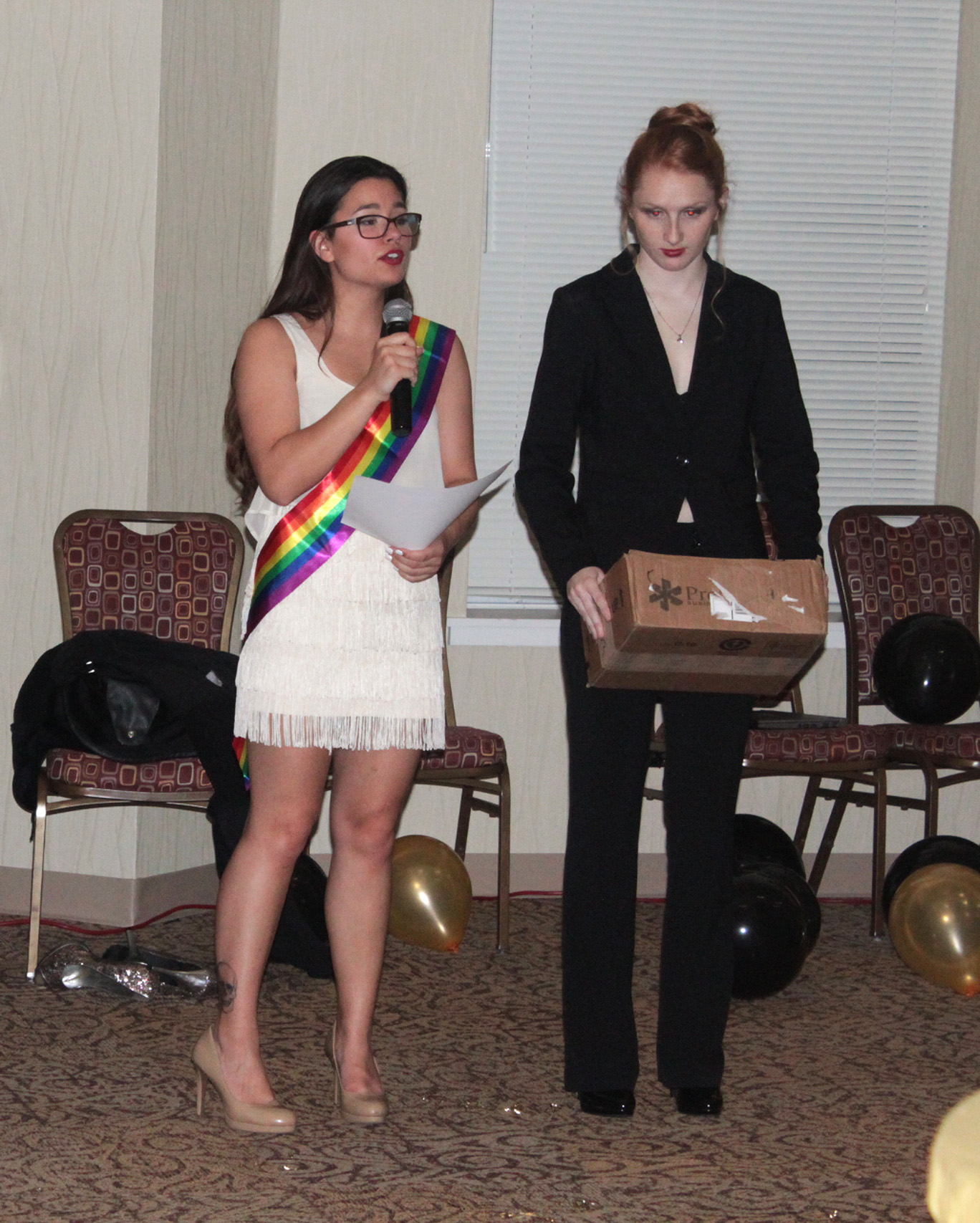 web Hunter Hart and Stephanie Miller handing out awards at the GSA Prom Wednesday April 6, 2016