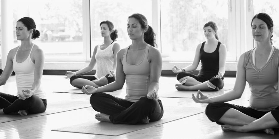 Women+practicing+yoga+in+a+class