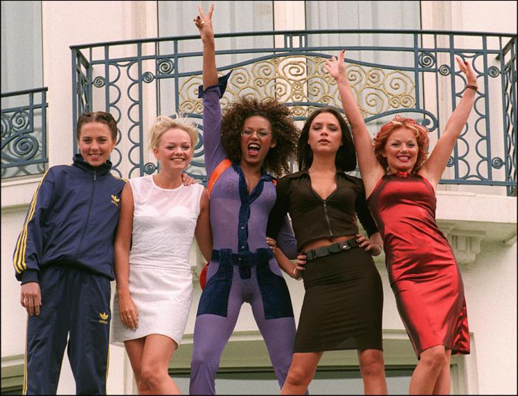 Cannes, FRANCE: (FILES) The Spice girls pose for photographers in front of Cannes Martinez Hotel 11 May 1997 as the 50th International Film Festival in Cannes goes on. Pop group the Spice Girls announced 28 June 2007 they are to reform for a world tour, saying girl power is back and stronger than ever, in a statement posted on their website. AFP PHOTO BERTRAND GUAY (Photo credit should read BERTRAND GUAY/AFP/Getty Images)