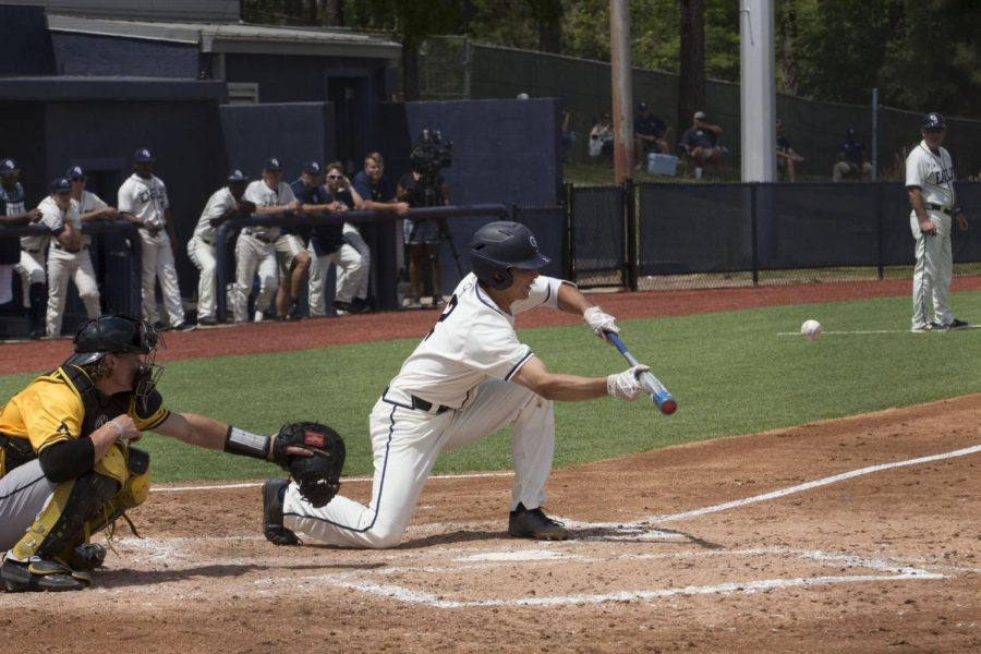 Shortstop Evan McDonald bunts during a game against Appalachian State. McDonald has started 27 games and has 13 RBIs this season.