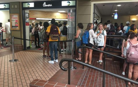 Students wait for their food in the dining area of Chick-Fil-A.