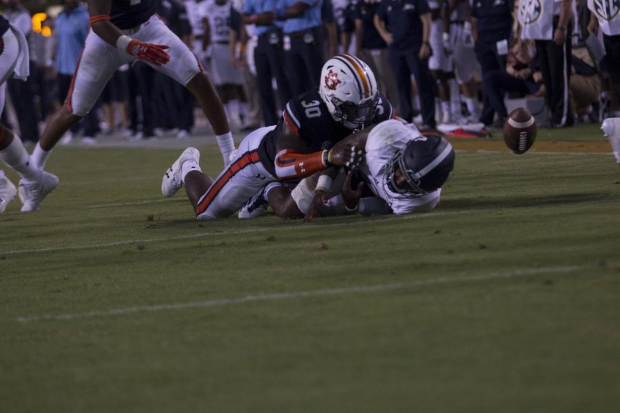 Shai Werts is taken down by Auburn linebacker Tre' Williams. Williams had 10 tackles to lead the Tigers.