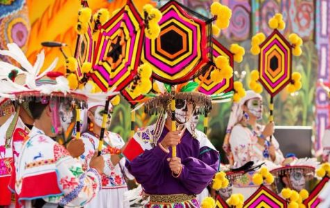 Día de los Muertos is a lively and colorful tradition celebrated in Mexican cultures. Participants can be seen celebrating by dressing as calacas (skeletons) and honoring the lives of loved ones who have passed. Photo courtesy of www.latimes.com.