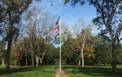 The flags at Sweetheart Circle will fly at half staff on Monday and Tuesday to honor the lives of Deacon and Garrett Harris who were killed in a car crash on Sunday, Nov. 26. Photo by Matthew Enfinger.