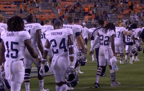 GS walks off the field after the 41-7 season-opening loss at Auburn's Jordan-Hare Stadium.