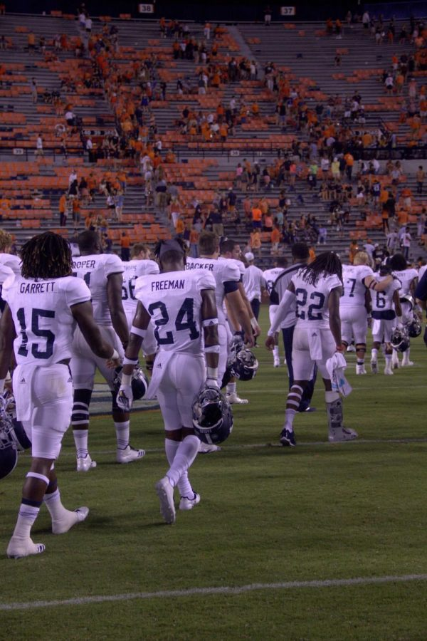 GS walks off the field after the 41-7 season-opening loss at Auburn's Jordan-Hare Stadium.