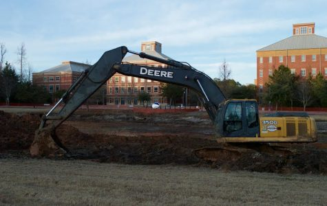 The pond in front of theNursing and Nursing/ Chemistry and College of Education building remains under construction. Piles of sediment is scooped from the bottom of the ponds to increase its depth. Photo by Matthew Enfinger