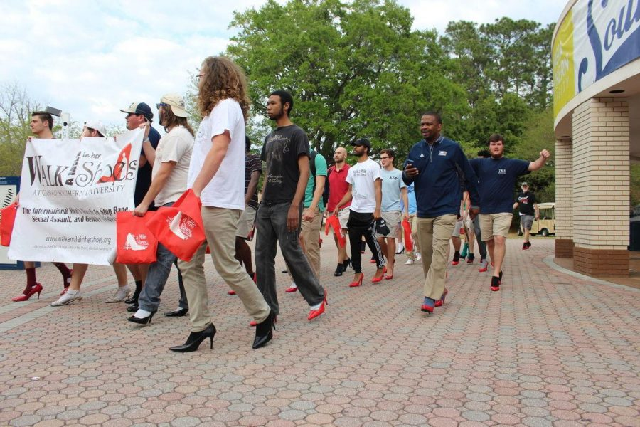 Male walkers wear high heeled shoes to raise awareness for male led sexual assault in Walk a Mile in Her Shoes.