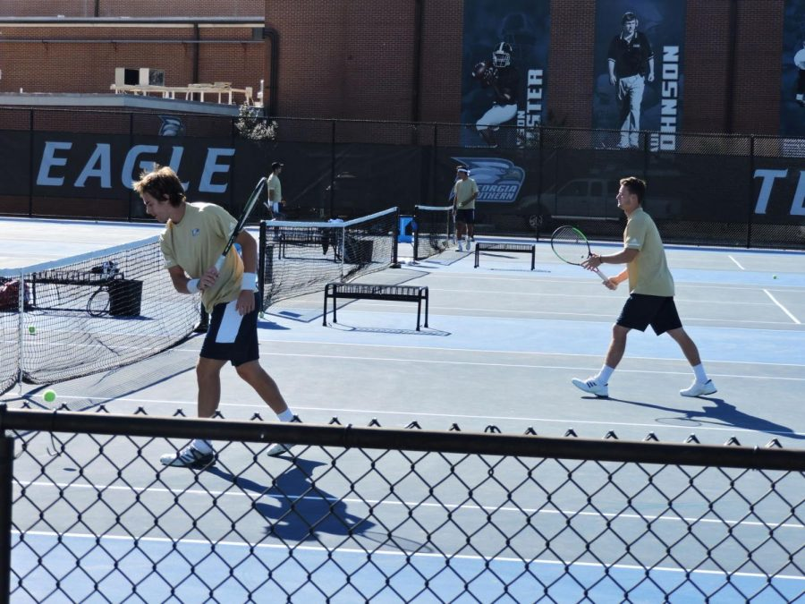 The men's tennis team improved to 4-1 at home.