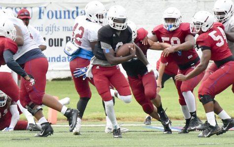 Redshirt-junior quarterback Dewann Ford alludes a tackle in a South Carolina State scrimmage.