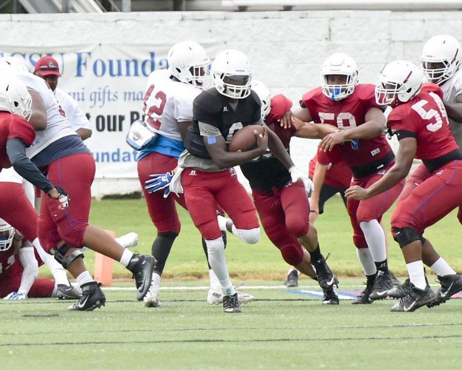 Redshirt-junior+quarterback+Dewann+Ford+alludes+a+tackle+in+a+South+Carolina+State+scrimmage.%C2%A0