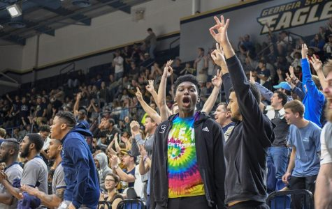 Fans react to a made three-pointer in a GS victory over South Alabama. Men's basketball garners the second highest attendance numbers, at 1,725.4 per game.