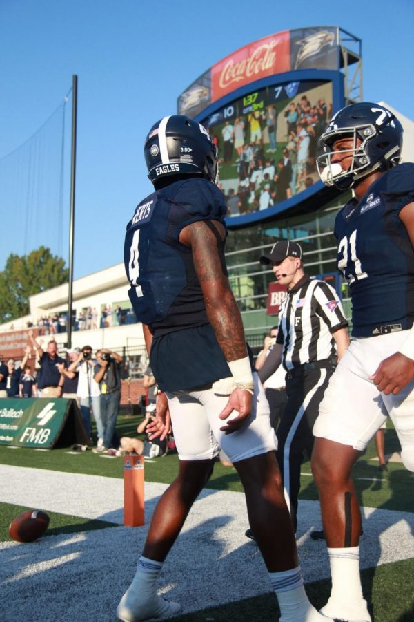 Redshirt sophomore quarterback Shai Werts celebrates with senior Wesley Fields after a touchdown last season.