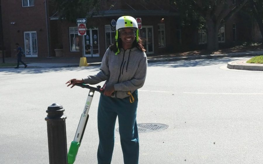 Jordan Wheeler, freshman multimedia and film production major, tests out one of the Lime scooters.