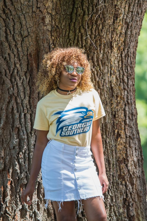 T-shirts are the perfect option when you want to be comfortable, but still rep school spirit at the games. T-shirts can be worn out, tucked into skirts and shorts, or tied up on the side.