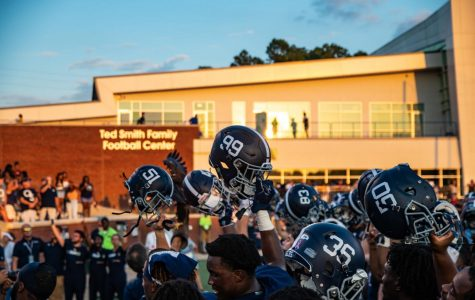 The Eagles held their helmets high for the Georgia Southern alma mater.