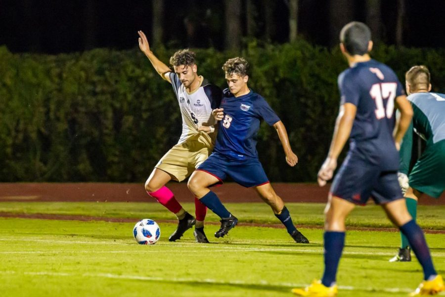 Sophomore Gonzalo Talavera wards off a player in the game against Florida Atlantic. Talavera played for Atletico Madrid.
