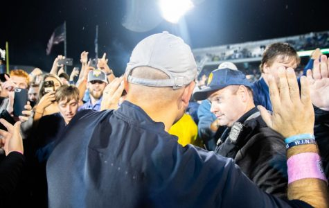Head Coach Chad Lunsford celebrates the win over Appalachian State with the students who had stormed the field.