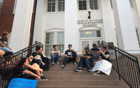 Students sit on the steps of the Marvin-Pittman Building while the march organizers meet with Nickel, Lewis and the university's lawyer.