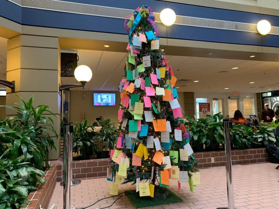 The+Holiday+Helper+Tree+started+its+25th+anniversary+on+Nov.+1.+To+participate%2C+students+can+grab+a+tag+off+the+tree+located+in+the+Russell+Union.