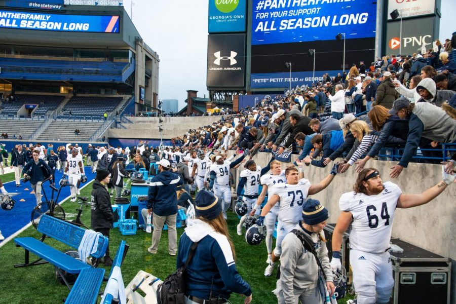 Georgia Southern players show their appreciation for the traveling fans after Saturday's win against Georgia State.