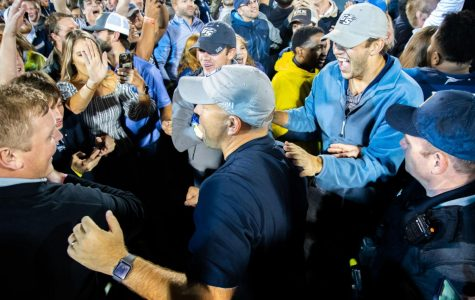 Head coach Chad Lunsford gets swarmed by fans following the win against Appalachian State. Lunsford has accumulated $15,000 this season in bonuses.