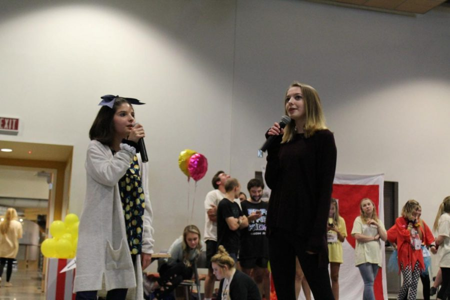 Anna Grace Tully (right) sings Wicked's 'Popular' with her sister. Tully was able to experience touch for the first time in her life after Children's Hospital repaired her tethered spinal cord.