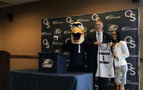 Georgia Southern Athletic Director TomKleinlein presented Howard with a No. One jersey which had her name printed on the back.