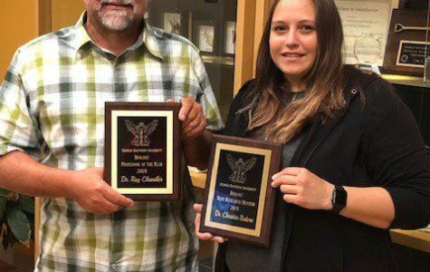 Georgia Southern biology professors Ray Chandler, Ph.D. (left), and Christine Bedore Ph.D., received Tribetaawards for their collaboration with students during research lab and participating in events sponsored by TriBeta.