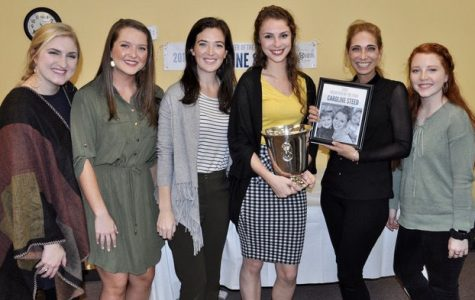 Caroline Steed (yellow shirt), a communication sciences student at Georgia Southern University, receives the 2019 Annie F. Oliver Volunteer of the Year Award.