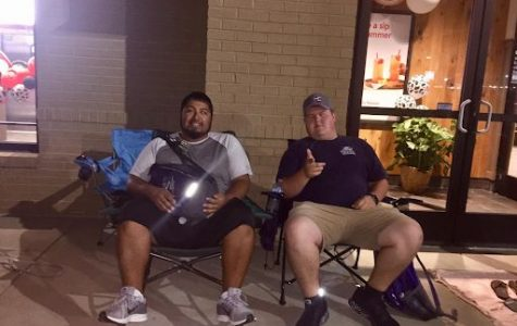 Sergio Arreguin (left) and Ryan Jackson (right) camped outside the building from as early as 4 a.m. till open at 6 a.m.